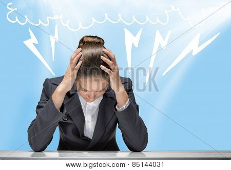 Young troubled businesswoman with hands on head