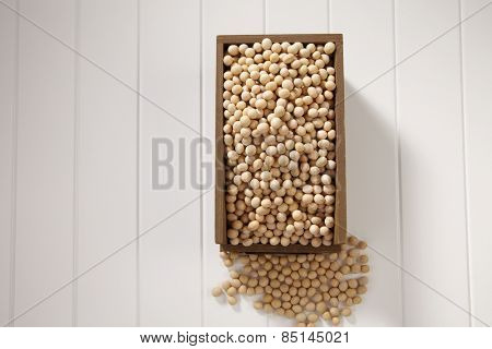 top view of soy bean in a wooden container