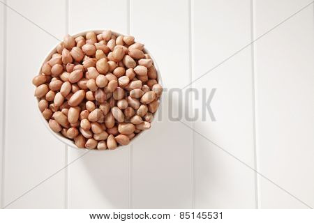 top view of the ground nut in a white bowl