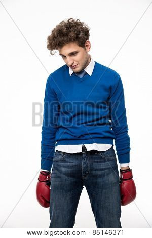 Portrait of a defeated young man over white background