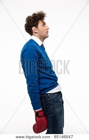 Side view portrait of a defeated young man over white background