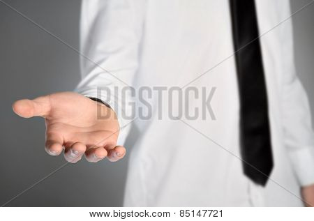Isolated business man give hand