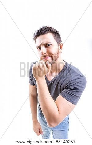 Young cool man thinking on white background