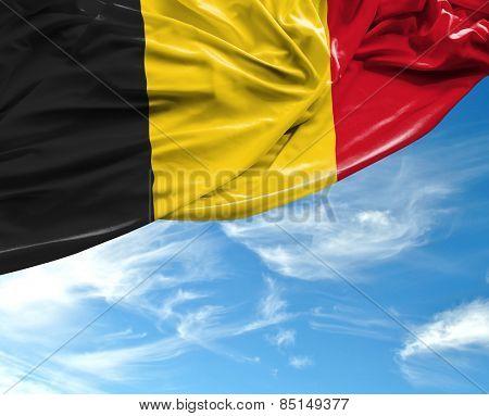 Belgian waving flag on a beautiful day