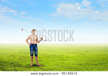 Young boy with fishing rod on shoulder