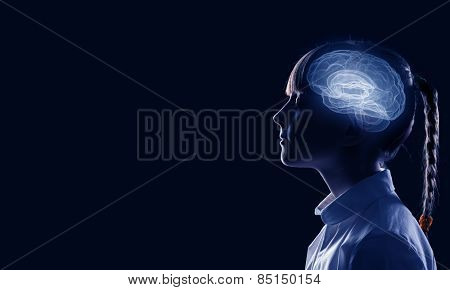 Young thoughtful girl of school age with closed eyes