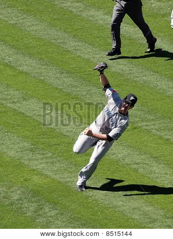 Blue Jays Lyle Overbay Stands Off Balance After Making A Running Catch For A Fly Ball