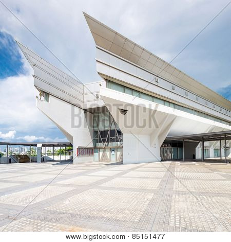 kallang,Singapore-July 1,2014: panoramic skyline and singapore indoor stadium exterior.Singapore Indoor Stadium is an indoor sports arena, located in Kallang,