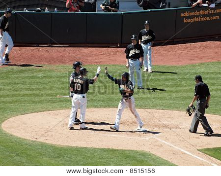 Athletics Coco Crisp Raises Hand To High Five Daric Barton As He Crosses Homeplate