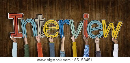 Group of Hands Holding Interview Word Concept