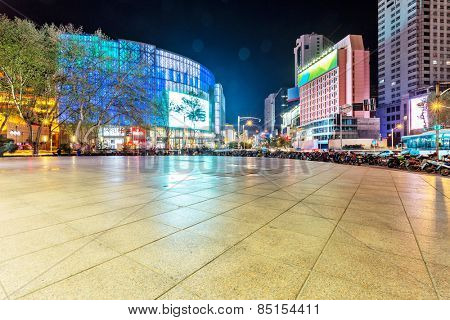 empty square and commercial buildings in modern city