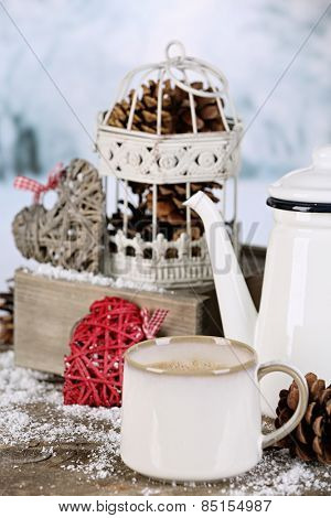 Winter composition with hot beverage on nature background