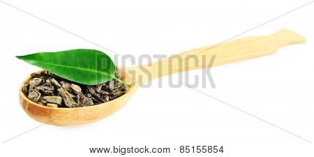 Wooden spoon with green tea with leaf isolated on white