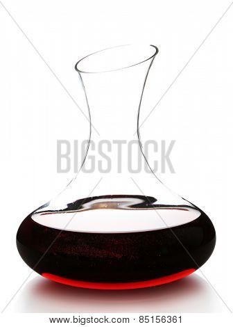 Glass carafe of red wine isolated on white
