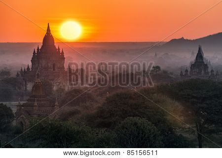 Enchanting sunrise in a misty morning over the Bagan religious site in Myanmar
