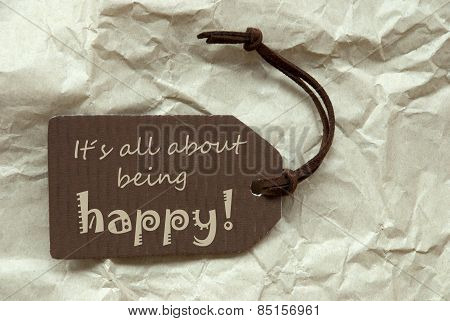 Brown Label With Quote About Being Happy Paper Background
