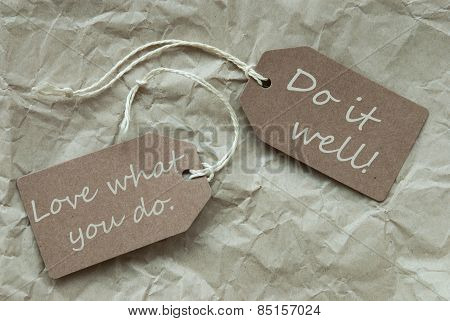 Two Beige Labels With Quote Love Do Well Paper Background