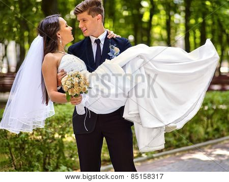 Bride and groom with flower summer  outdoor.