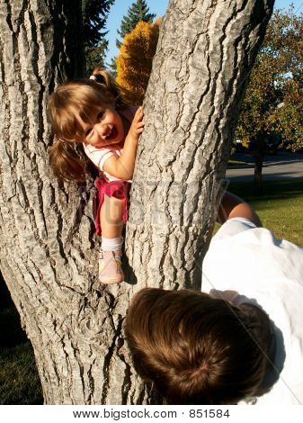 Girl and mom playing on the tree