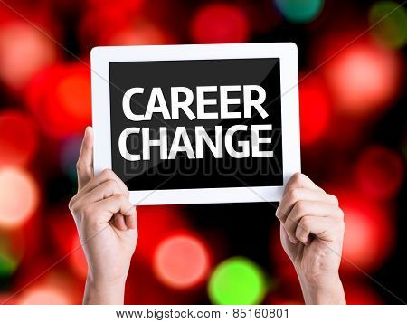 Tablet pc with text Career Change with bokeh background