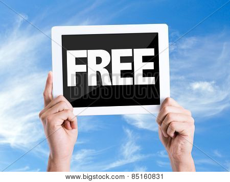 Tablet pc with text Free with sky background
