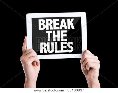Tablet pc with text Break the Rules isolated on black background