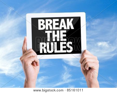 Tablet pc with text Break the Rules with sky background