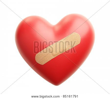 Red heart with plaster isolated on white