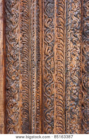 DOHA, QATAR - MARCH 8, 2015: Detail of traditional Arab carving on an antique door frame in Souq Waqif shopping area, a popular tourist attraction.