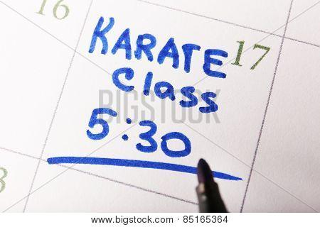 Written plan Karate Class on calendar page background