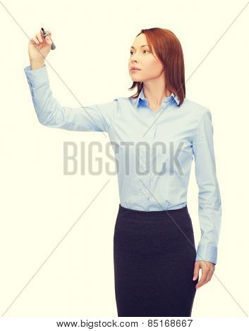 office, business and new technology concept - smiling businesswoman writing something in the air with marker