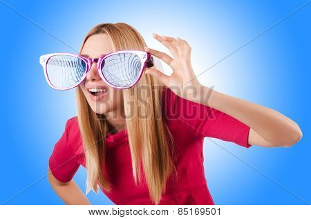 Tall model with giant sunglasses