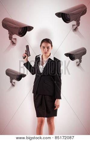 Businesswoman holding a gun against cctv camera