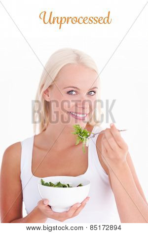 The word unprocessed against smiling woman eating salad