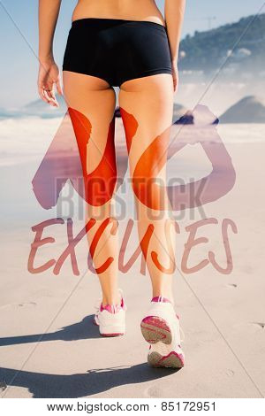 Fit woman walking on the beach against no excuses