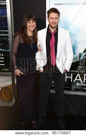 NEW YORK-MAR 4: Director Neill Blomkamp (R) and writer Terri Tatchell attend the premiere of