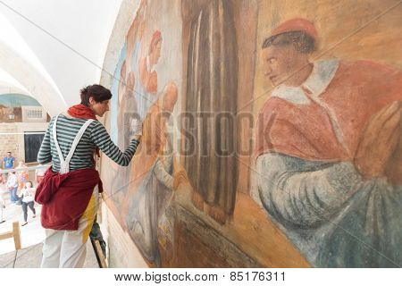 DUBROVNIK, CROATIA - MAY 26, 2014: Art conservation and restoration in the Franciscan Monastery in Dubrovnik.