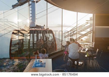DUBROVNIK, CROATIA - MAY 26, 2014: Family sitting in restaurant near Dubrovnik cable car station. Cable car connects Ploce and mountain Srdj above town where you can enjoy a panoramic view of Old Town