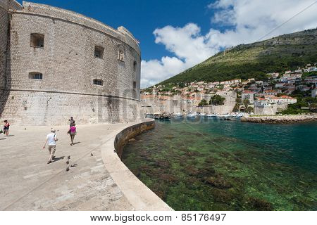 DUBROVNIK, CROATIA - MAY 27, 2014: Tourists in front of the St. John fortress near the old port. Fortress houses the Maritime Museum and the aquarium.