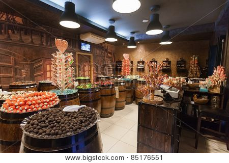 DUBROVNIK, CROATIA - MAY 28, 2014: Interior of the Candy shop Mateo with impressive range of treats, including chocolate, bonbons, and gummy bears all presented in pirate crates and barrels