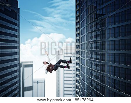 skyscaper background and falling business man