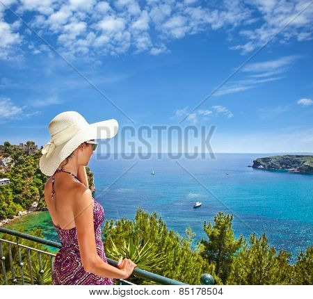 Beautiful woman looking on Valtos beach near Parga town of Syvota area in Greece.