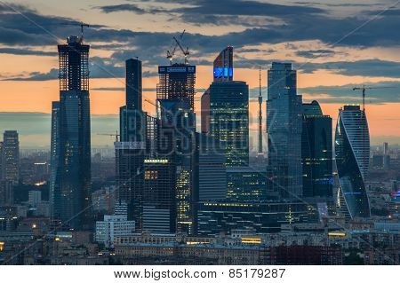 MOSCOW, RUSSIA - MAY 24, 2014: Cityscape of skyscrapers of Moscow City business complex and sunset. Moscow International Business Center Moscow City includes 20 futuristic buildings