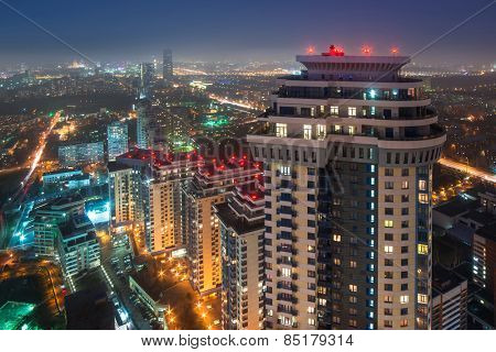 MOSCOW, RUSSIA - NOV 10, 2014: High-rise apartment complex Sparrow Hills and panorama of city. Sparrow Hills complex consists of seven buildings with a total area of 315 sq. meters