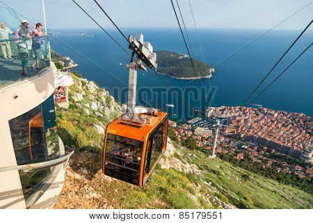 DUBROVNIK, CROATIA - MAY 26, 2014: Tourists at Cable car which connects Ploce and  mountain Srdj above town where you can enjoy a panoramic view of Old Town and the surrounding islands.