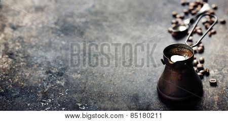 Old coffee pot on dark rustic  background