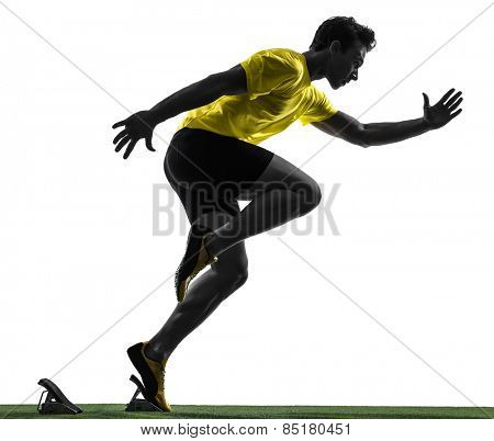 one  man young sprinter runner in starting blocks silhouette studio on white background