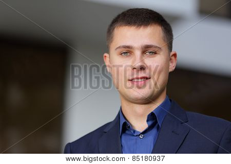 Headshot of a handsome smiling businessman