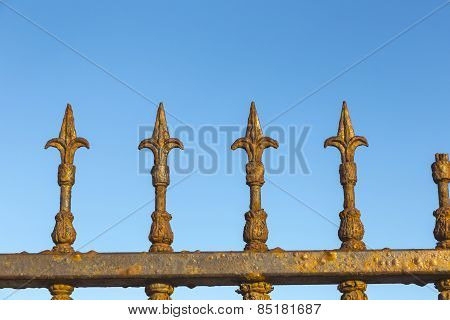 Decorative Steel Gate Against Blue Sky