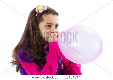 Beautiful child blowing a balloon